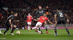 Manchester United's English striker Marcus Rashford (C) has an unsuccessful shot during the UEFA Europa League round of 16, second leg football match between Manchester United and Liverpool at Old Trafford in Manchester, north west England on March 17, 2016. / AFP / OLI SCARFF