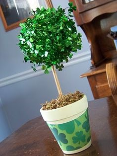 What about for the seasonal centerpieces we stick with the same make-up like this topiary? All we would need is a styrofoam ball and whatever we want to decorate it with and then the sticks and pots.