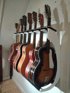 Guitar Stand - Always Wanted To Learn Guitar? Guitar Room, Guitar Wall, Cool Guitar, Guitar Garage, Home Music Rooms, Guitar Display, Guitar Cabinet, Guitar Hanger, Recording Studio Home