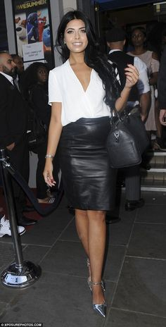 Leggy lady! Clad in a cream blouse and leather pencil skirt, Cara looked effortlessly glam...