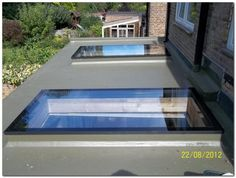 These contemporary skylights add plenty of natural light to this flat roof extension. Contemporary Skylights, Contemporary Front Doors, Flat Roof Skylights, Roof Extension, Extension Ideas, Extension Google, Roof Lantern, Roof Window, Front Door Design