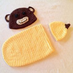 Crocheted Toddler Monkey Hat and Newborn Banana Hat with Cocoon - I've got to say the banana top looks like a nipple.