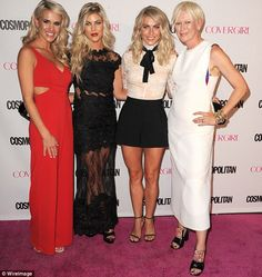 The three sisters pose on the carpet with Cosmopolitan's editor in chief, Joanna Coles...
