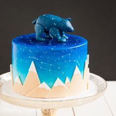 Baby Shower - A very special and unique baby shower cake for baby Ursa. The constellations after which she is named, Ursa minor and Ursa Major are painted on the side of the cake. We also put Ursa the bear on top of the night sky. Vanilla bean spice cake with spiced pumpkin buttercream.