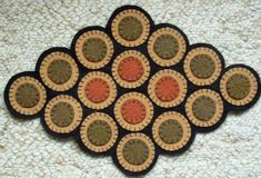 Penny Rugs!  A great way to use up those old wool skirts..and get a neat piece of an old time art just for yourself..