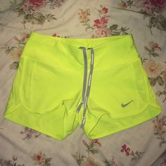 Neon yellow Nike shorts Cute shorts but there to small for me.in great shape no flaws or holes, stains, snags. Nike Jackets & Coats