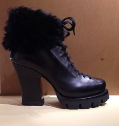 Leather & fur ankle boots by @Prada #Prada #boots #FolliFollie #FW14collection