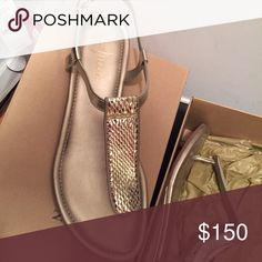 Cole Haan Metallic Gold Sandals Comes with the original box. Brand new, no sign of wear and tear. They are very comfortable!!!! Awesome metallic color. I have matching purse in my closet as well. If you want both, I will discount the bundle. Cole Haan Shoes Sandals