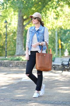 How to style a baseball cap via Peaches In A Pod blog. Cute baseball hat style with black distressed denim, Chuck Taylor sneakers, striped tunic, denim vest and brown tote.