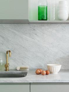 Solid slab backsplash and countertops