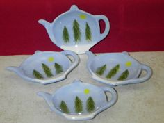 Set of 4 tea bag holders. Approximately 3 1/4 X 4 1/4 hand painted (no two are exactly alike) in our pines in the snow design This makes a great gift.  They can be used as a tea bag holder, spoon rest, ring holder, brillo holder or lollipop / gum catcher. Buy more than one set and save on shipping!  They are dishwasher safe.  Pa. residents please add 6% sales tax.($1.20)