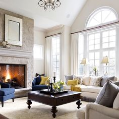 Great sunny living room with cozy stone fireplace