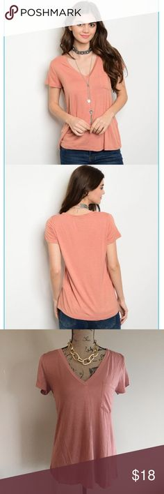 💥Just in💥 Apricot basic pocket top The perfect basic top for every wardrobe! This rich apricot tee has a silken texture rare to find in a basic piece. V neck, accent pocket and a slight sheen. 95% rayon, 5% spandex. Versatile, lending itself to be worn with jeans or a pencil skirt. A must-have for this spring🌺 (XS-0, S-2/4, M-6/8, L-10/12, XL-14 Tops Tees - Short Sleeve