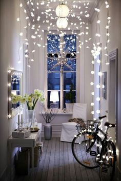 Twinkle, Twinkle - beautifully styled interior with a clever use of fairy lights for decoration / from the Ikea Christmas catalog .