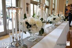 Could be burlap & Satin here, too--Candles inside hurricanes with simple footed arrangements--elegant