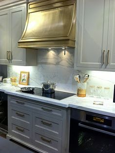 Beautiful brass hood  Bloomsbury Fine Cabinetry