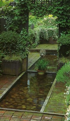 Using a mirror to extend water feature and garden.