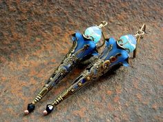 Like blazing little wands of blue fire, these ARE mesmerizing! From the twinkling indigo swarovski crystals at the