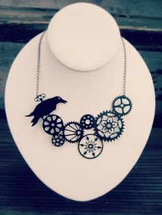 Steampunk jewelry - black steel raven necklace - whimsical gear silhouette statement necklace. $28.00, via Etsy.