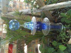Glass Garden Totem made of household glassware.