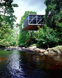 The Basil Goulding house hangs over the Dargle River in Enniskerry, Ireland; designed by Scott Tallon Walker Architects