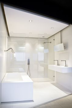 floor might be a little slick. Bathroom Showrooms, Bathroom Interior, Bathrooms, Design Bathroom, Showroom Design, Showroom Ideas, Modern White Bathroom, Bathroom Flooring, House Rooms