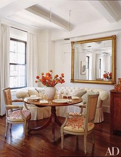 A warm palette of cream, gold, mahogany & rust + traditional styling--paired with a delicate mobile