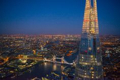 People at the top of The Shard at night, London.