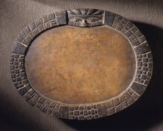 """""""Ifa Divination Tray"""" (ca. 1920-1930). Nigeria, Keta area, Yoruba peoples. Wood with traces of white and blue pigment. Gift of Dr. and Mrs. Jeffrey S. Hammer. Posted on lacma.org."""