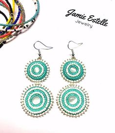 Turquoise and White Cats Eye Earrings, Beaded Embroidered Earrings, Cats Eye Earrings, Beadwork Earrings, Dangle Earrings, Disc Earrings by JamieEstelleJewelry on Etsy https://www.etsy.com/listing/532207611/turquoise-and-white-cats-eye-earrings