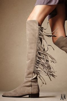 These Stuart Weitzman fringe boots are the perfect gift for a glamorous free spirit. Complete the style with bold prints.