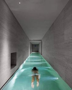 We came across this great indoor #pool designed by Gerda Vossaert Architect on @davidegroppi's portfolio. Davide's Nulla #lighting fixtures were designed to look like holes in the walls, or in this case the ceiling.