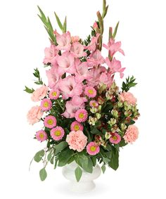 Vivid Memories is just one of the many funeral floral arrangements available on Frazer Consultants' Tribute Store, an online flower store available on all Frazer-powered funeral home websites. #Alstroemeria #Carnations #Asters #FloralArrangements