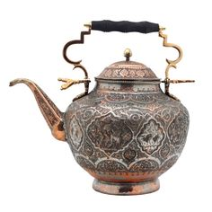 Persia  19th century  Antique Persian Copper Teapot. Copper teapot decorated with embossed and engraved scrolls and flower motifs along with several figural birds. Attached handle with wooden hand-hold. Lid is also embossed and engraved but with leaves and a geometrical motif around the perimeter and a hexagonal finial which acts as the handle. Circular base.