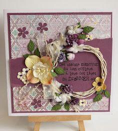 Et kort som er laget med mønsterark fra Prima - Royal menagerie. pyntet med blomster og glitterbånd.    Lagd til ei som elsker lilla. Tek...