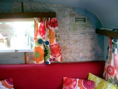 Cool idea to use map as wallpaper in a camper. Genius!