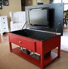 coffee table tv, not a fan of the actual table but still a great idea...imagine wheels on the bottom so you could roll it around according to the gathering type...pretty cool