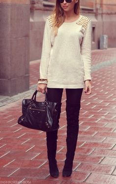 Love the femininity of the sweater, but the boldness of the gold spikes and leather details!