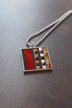 Ruby glass mosaic necklace with black caramel by ChicagoMosaics, $60.00
