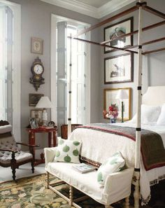 Mattes are same size in prints up wall beside bed. Lots going on but still serene. High ceilings help and that Benjamin Moore color, fusion. Home of designer and antique collector Furlow Gatewood.