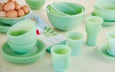 Love these green milk glass settings!