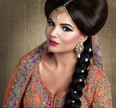 Stunning asian bride wearing purple, orange and red bridal outfit with braided hair and decorative pearls, as seen in the Asian Bride Magazine.   Bridal Portfolio image  Photography & Retouching: Diamond Retouch Creative Direction & Styling: Ami Rai Makeup - Salma Mannan  Hair - Sadia Mannan Model: Stuttee Em Outfit: Seema Sarfaraz Jewellery: NK Collection
