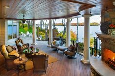 Lakeside paradise! Outdoor living space remodel by Lecy Bros. Homes of Minnesota.