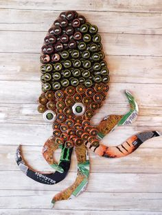 I would use beer caps and make the tentacles out of something else. Beer Bottle Crafts, Beer Cap Crafts, Bottle Cap Projects, Diy Bottle, Crafts To Do, Arts And Crafts, Bottle Top Art, Beer Cap Art, Aluminum Can Crafts