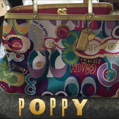 Coach Poppy Bag % Authentic Coach Poppy Bag. Beautiful and vibrant pops of pink, purple, teal, blues and greens adorn this fab bag! Accented with punches of gold. Interior has a coin purse style center enclosure with two roomy sides. Carried one time. PRISTINE condition! Beautiful and unique bag. Coach Bags