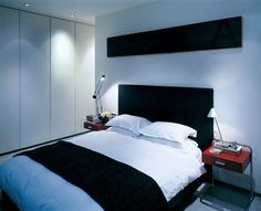 Minimalist bedroom design with black and white color.