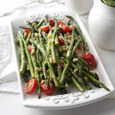 Tuscan Style Roasted Asparagus  Ingredients 1-½pounds fresh asparagus, trimmed 1-½cups grape tomatoes, halved 3tablespoons pine nuts 3tablespoons olive oil, divided 2garlic cloves, minced 1teaspoon kosher salt ½teaspoon pepper 1tablespoon lemon juice ⅓cup grated Parmesan cheese 1teaspoon grated lemon peel