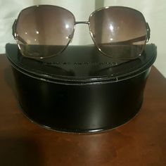 Oversized Marc Jacob's sunglasses Dark brown frame / lenses. Light surface scratches from use, but overall in great shape. Price is reflective. Comes with original case. Marc by Marc Jacobs Accessories Sunglasses