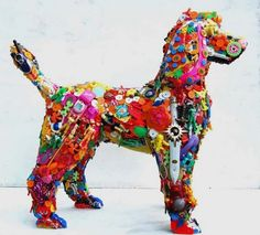 3D Plastic Dog Sculpture made from recycled plastic toys.Love this!