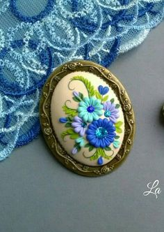 Check out this item in my Etsy shop https://www.etsy.com/listing/587303647/brooch-flower-filigree-polymer-clay